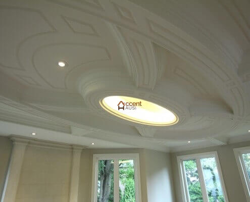 Arched paneled ceiling design with cove lighting