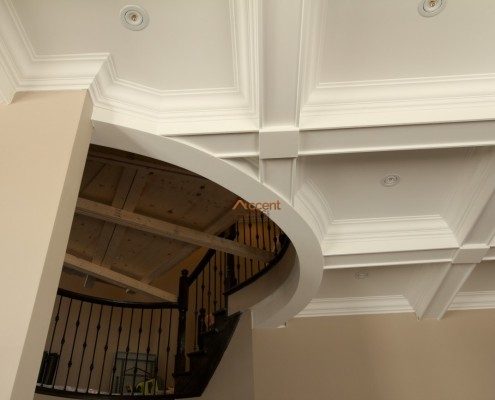 Patterned beam ceiling design in a house