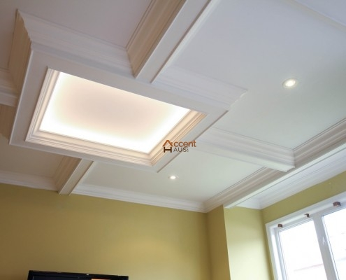 Light cove waffled ceiling decorated in a family room