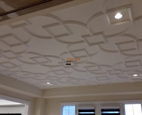 Flat patterned recessed ceiling for a family room